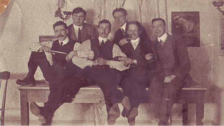 Sepia tone photo of a group of Edwardian men