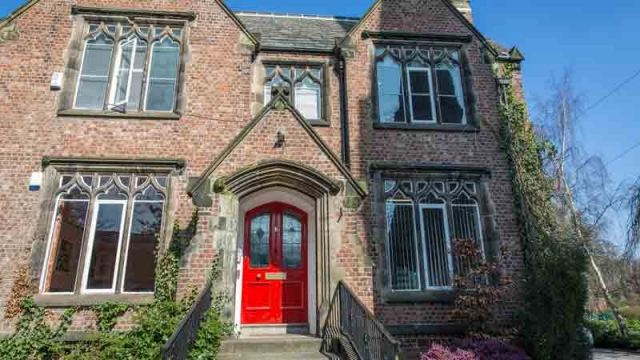 Front view of No6, a Victorian rectory with a red front door. Now converted and used for offices and meetings.