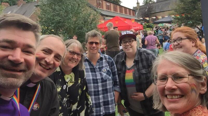 Smiling visitors at the first Didsbury Pride event at Emmanuel