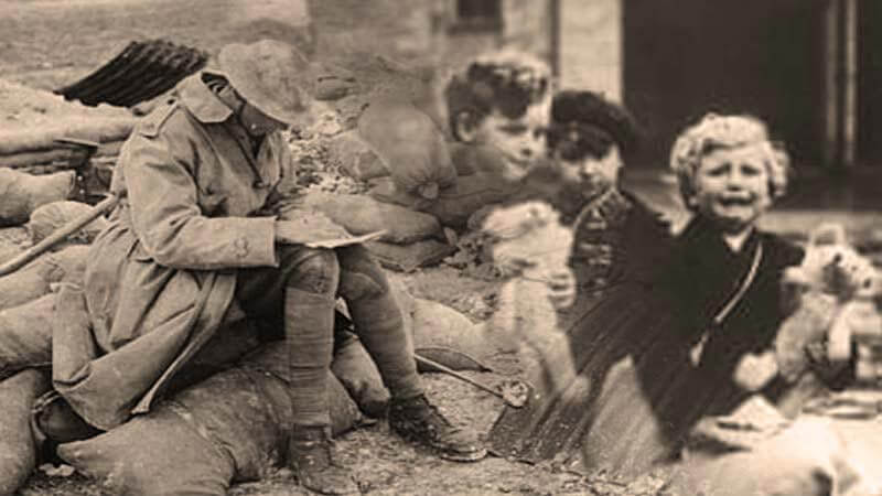 Archive photograph showing a First World War soldier writing a letter home - with superimposed photo of sad children missing their father