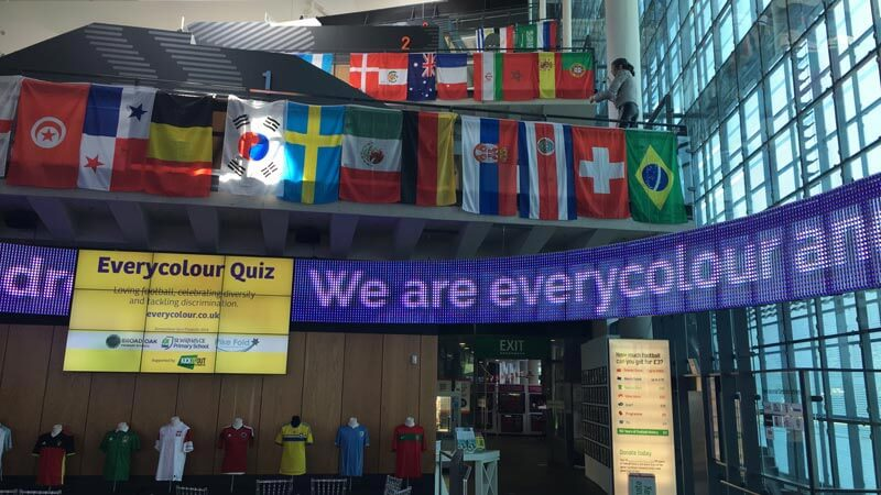 The moving signage in the National Football Museum display the slogan 'We are every colour'
