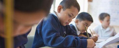 Pupils concentrating as they write during an school test