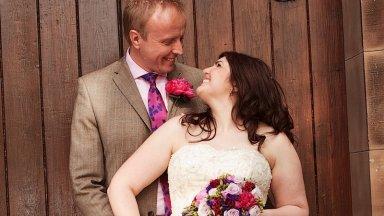 Happy just married couple posing in St James doorway