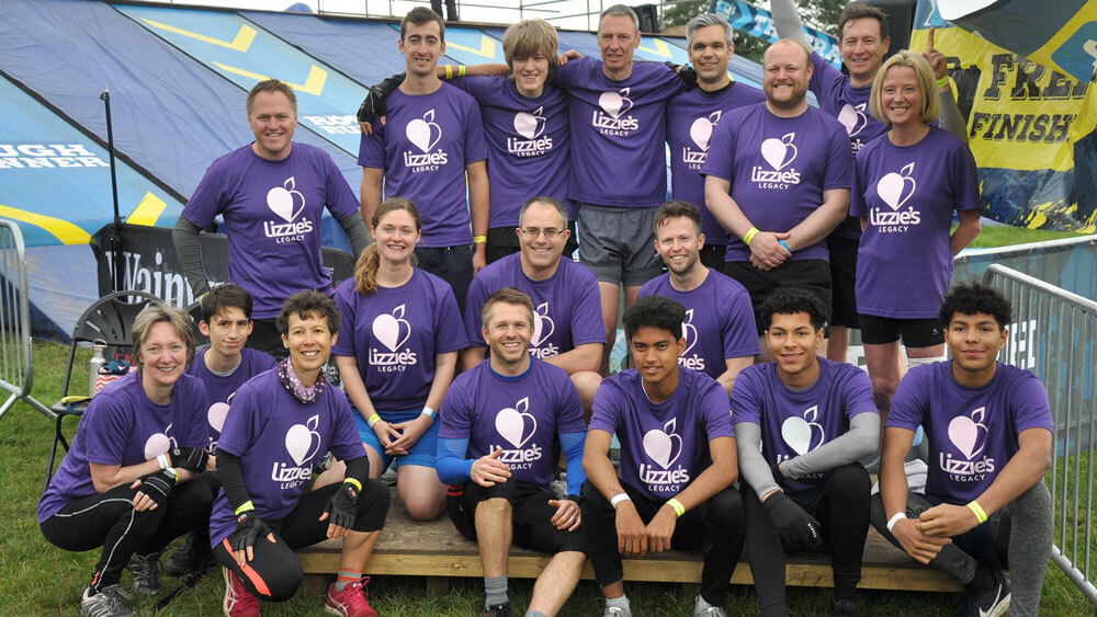 A smiling group of rough runners before they embark on the course