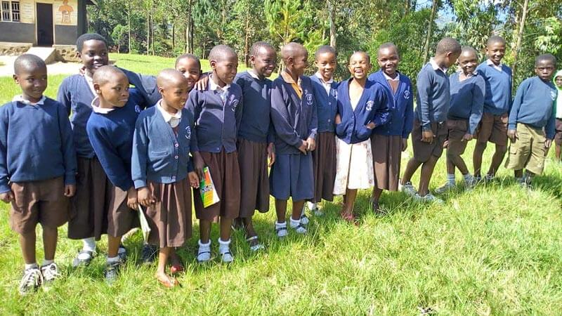 Children from the Potters Village wearing uniforms donated by Didsbury CE