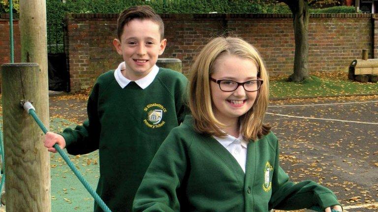 Two pupils wear the new St Elisabeth's CE uniform