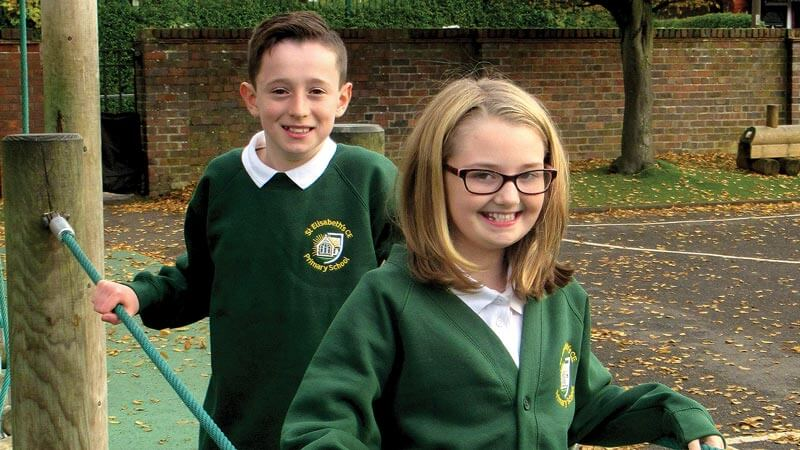 Twp pupils wear the new St Elisabeth's CE uniform