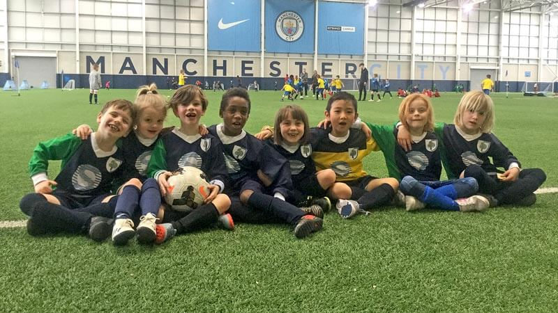Happy football team of girls and boys
