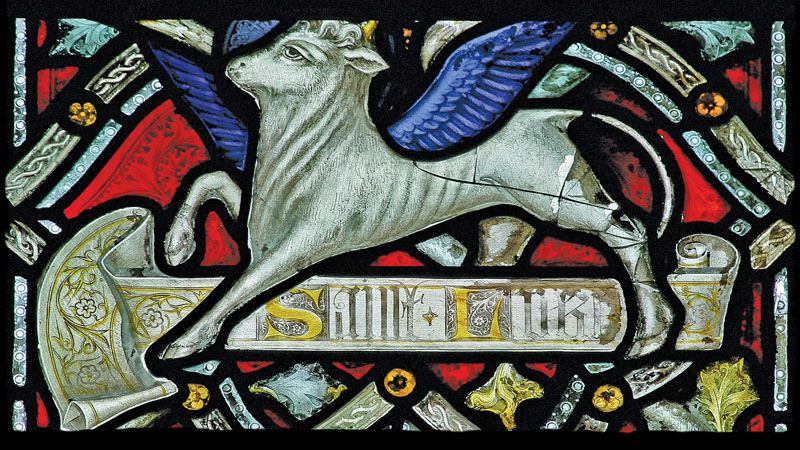Detail of Emmanuel stained glass depicting a winged ox – the symbol for St Luke