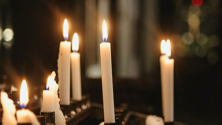 Lit candles near the altar