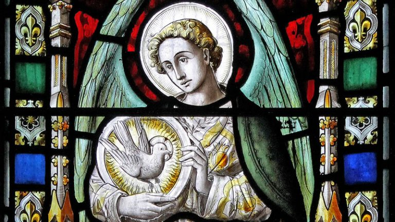 Detail of stained glass window featuring an angel holding a white dove