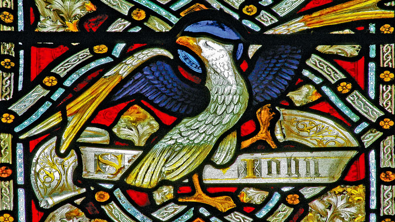 Detail of a stained glass window in Emmanuel depicting an eagle representing St John