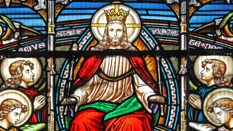 Detail of a stained glass window in Emmanuel depicting Christ in glory wearing a crown of gold