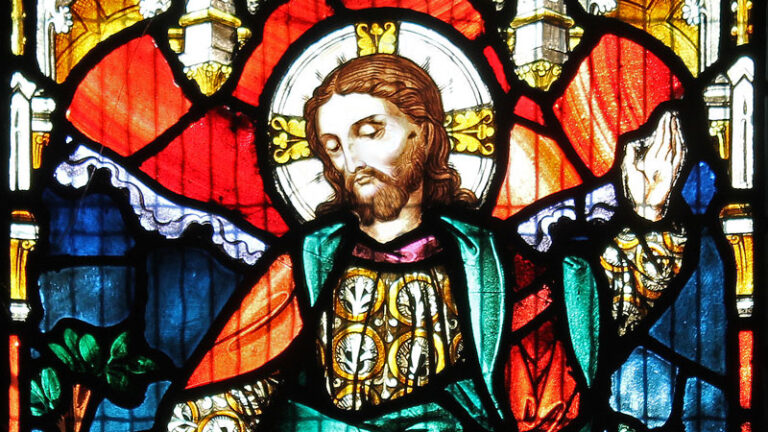 Detail of a stained glass window in Emmanuel depicting the risen Christ