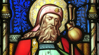 Detail of a bearded male figure from a stained glass window in St James church